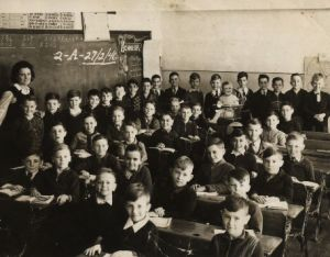 Teacher and students in school old photo
